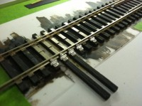 Adjustable rail braces.